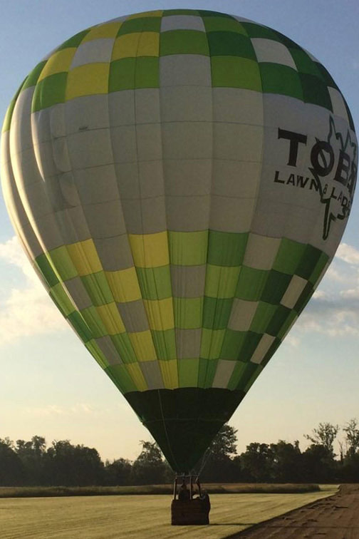 Image of Tobys Lawn and Landscaping hot air balloon